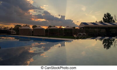 Reflected sunset and clouds timelap - Reflected sunset and...