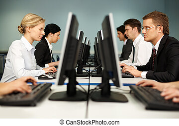 Computer class - Image of smart people sitting at the tables...