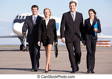 Business team - Image of business team walking through the...