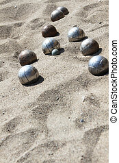 Playing of bocce in the sand - Balls for playing bocce on...