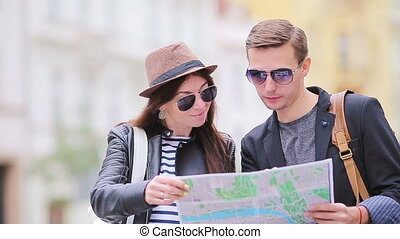 Happy tourist couple traveling on holidays in Europe smiling...