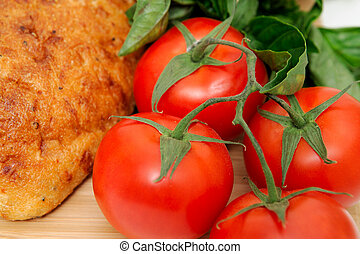 Tomatoes And Old Style Bread - Close-up of unsliced old...