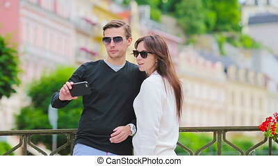 Selfie photo by caucasian couple traveling in Europe....