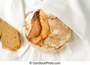 fresh artisan bread in white napkin