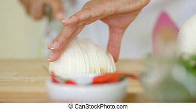 Close up on hands Cutting fresh onion - Close up on female...