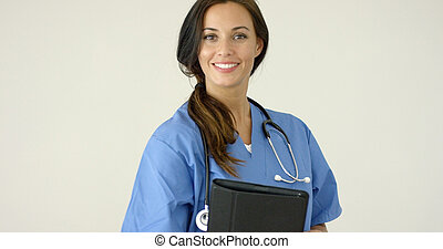 Smiling young female physician smiles at camera while...