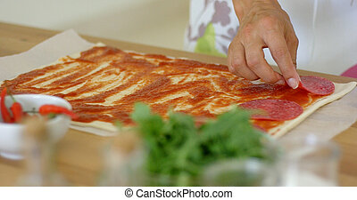Woman making a traditional Italian pizza