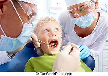 Dental examination - Image of little boy having teeth...