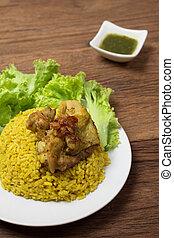 Thai chicken biryani Khao Mok Gai or Yellow curry rice Thai...