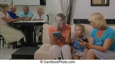 Grandmothers with electronics and little grandson -...