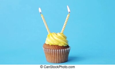 birthday cupcake with two burning candles - holiday,...