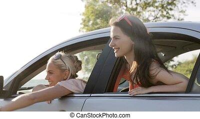 happy teenage girls or women in car at seaside 11 - summer...