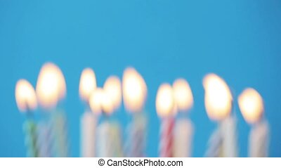 birthday candles burning over blue background - holiday,...