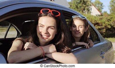 happy teenage girls or women in car at seaside 62 - summer...