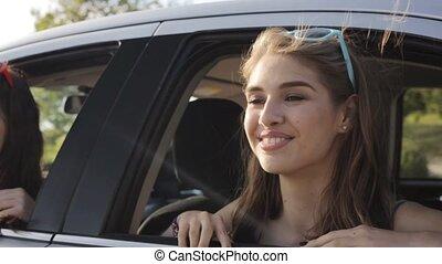 happy teenage girls or women in car at seaside 21 - summer...