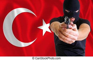 Concept of coup in Turkey. Masked armed man.