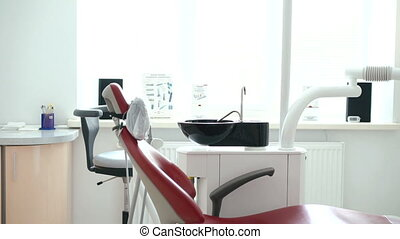 Dental clinic interior design with chair and tools in full...