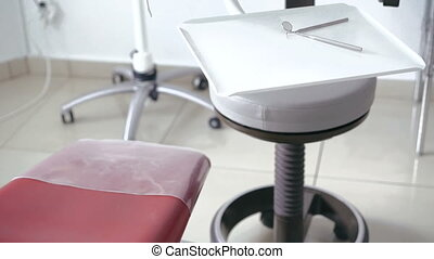 Modern dental tools, many instrument, chair in full HD