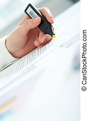 Accounting - Close-up of female hand holding marker over...