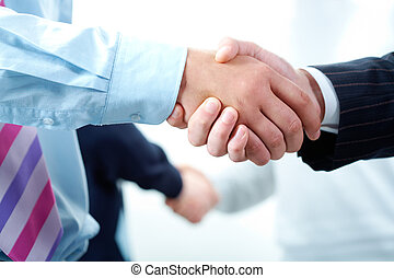 Agreements - Image of business peoples hands making the...