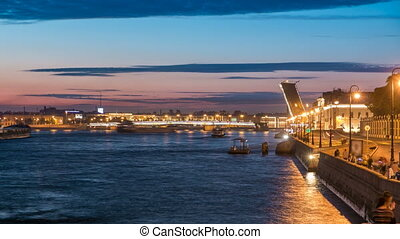 Span of the Liteyny Bridge is lifted over the river Neva...