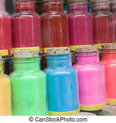 color powder - various color pigments in a window display