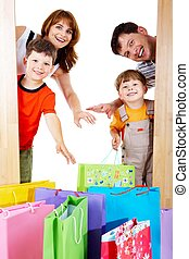 Joyful shoppers - Image of cheerful family members near...