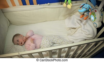 Baby on a bed in the bedroom