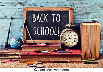 text back to school written on a chalkboard