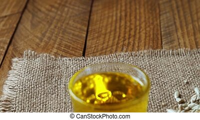 oil and Seeds - cooking oil and Seeds of sunflower, close-up
