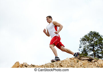 Healthy athlete - Image of healthy athlete running down...