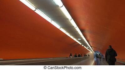 People on flat escalator - Unidentified people walking along...