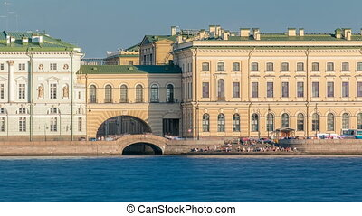 People on the Hermitage Bridge and stairs near the Neva...