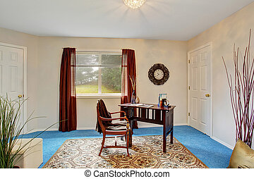 Cozy home office interior with blue carpet floor