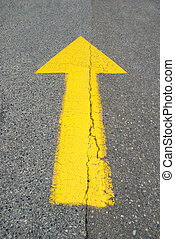 Yellow arrow pointing up - Yellow painted arrow on asphalt...