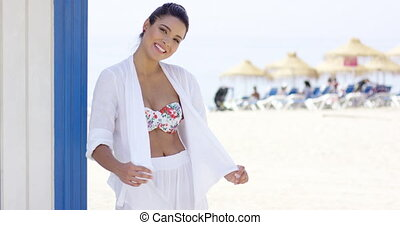 Cheerful pretty woman in white robe on beach - Beautiful...