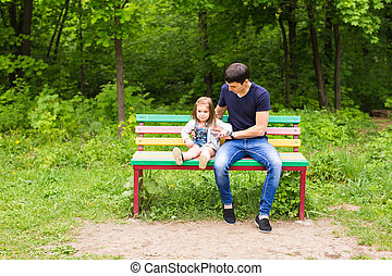 loving father with a daughter in the park