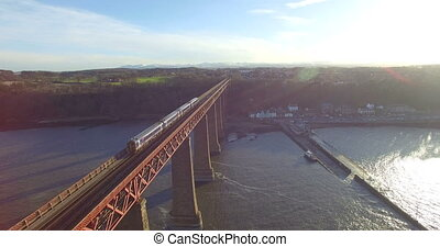 Aerial: Train on Forth Rail Bridge in Queensferry,...