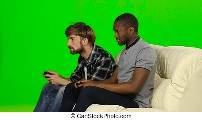 Men playing video games against each other Green screen -...