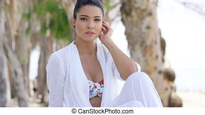 Confident woman in tropical beach scene - Single young adult...