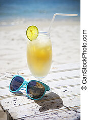 Fresh tropical cocktail with rum on beautiful sunny beach