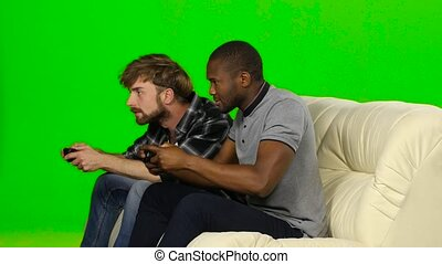 Man is loser on the console and is angry. Green screen