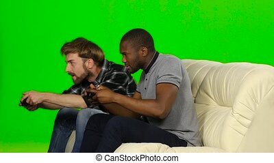 Men won the game on the console. Green screen - Men play on...