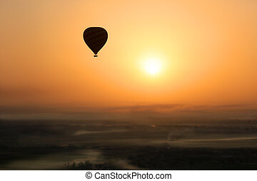 Hot air balloon, Egypt sunrise - Hot air balloon silhouetted...