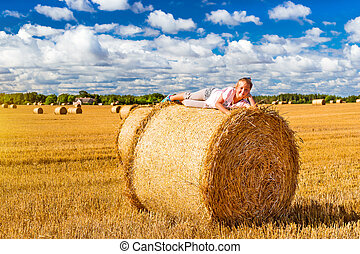 Stacks of straw - bales of hay, rolled into stacks - Cute...