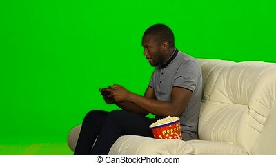 Man won in the game on the console and happy. Green screen -...
