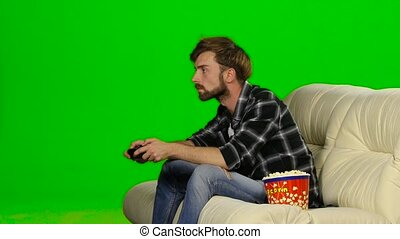 Man lost in a computer game. Green screen - Guy holds the...