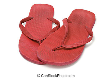 flip-flops - a pair of flip-flops isolated on a white...