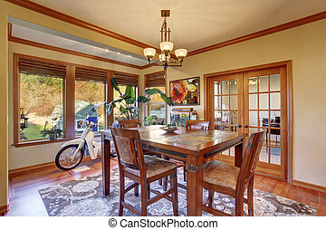 Dining area with hardwood floor Wooden table set - Dining...