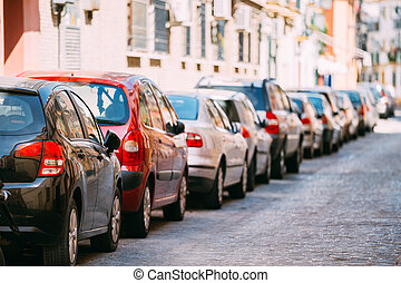 Cars Parked On Street In European City In Summer Day. - Cars...
